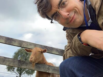 John with a curious goat